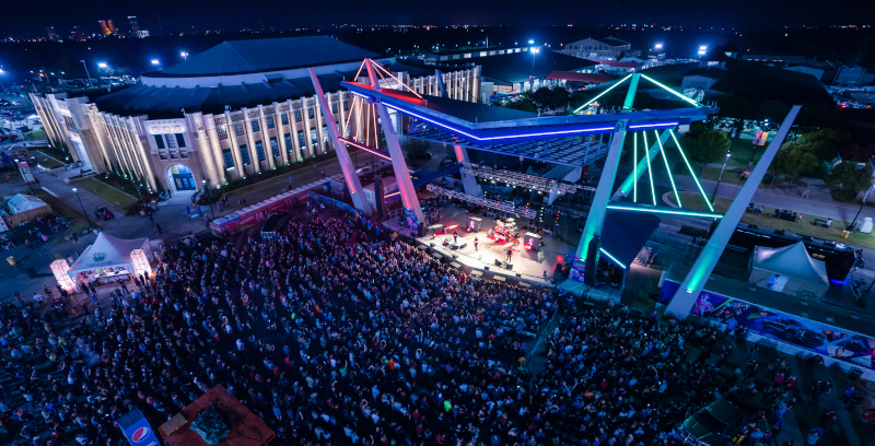 Expo Square aerial view of a band playing at night.