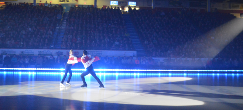 Keystone Centre ice rink with two figure skaters being watched by the crowd.