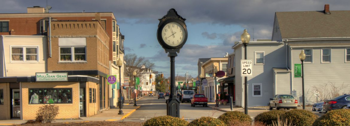 Mansfield, Massachusetts view of N Main downtown with a clock front and center.