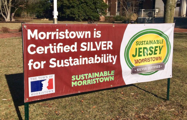 "Sustainable Jersey, a sign in the grass saying ""Morristown is Certified SILVER for Sustainability""."