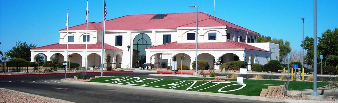 Adelanto, California city building with Adelanto spelled in the grass.