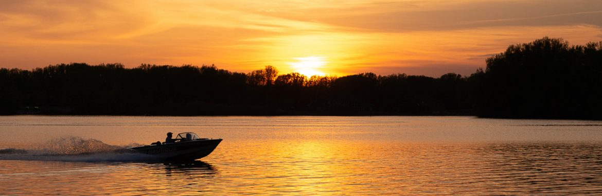 Albert Lea, Minnesota edgewater park boating at sunset. Photo by Teresa Kauffmann.