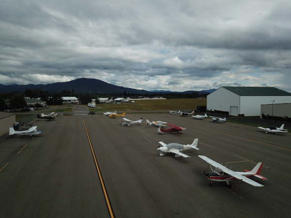 Coeur d'Alene Airport (Pappy Boyington Field) view of a bunch of small craft parked on the airport grounds.