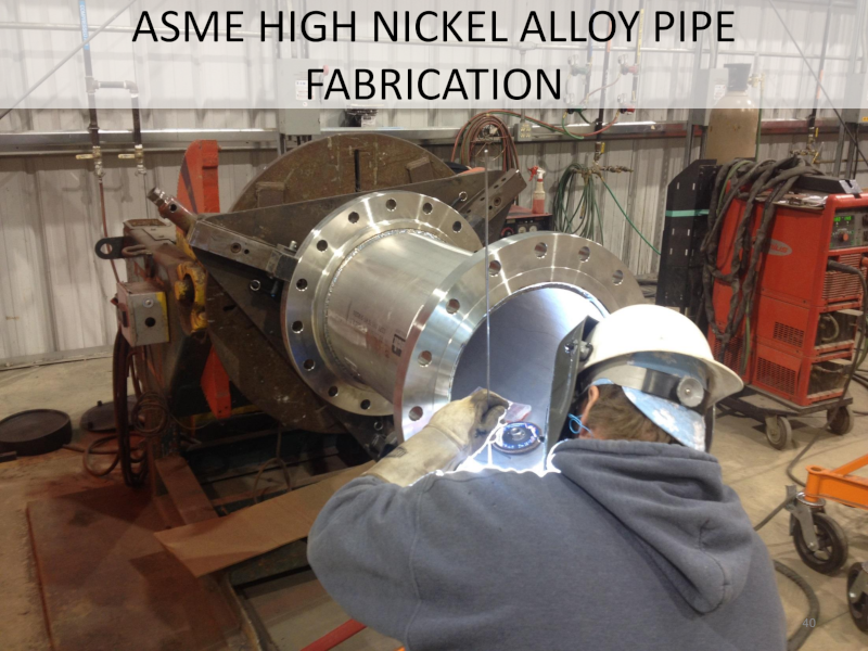 Great River Industries ASME High Nickel Alloy Pipe Fabrication with an employee working on a pipe.