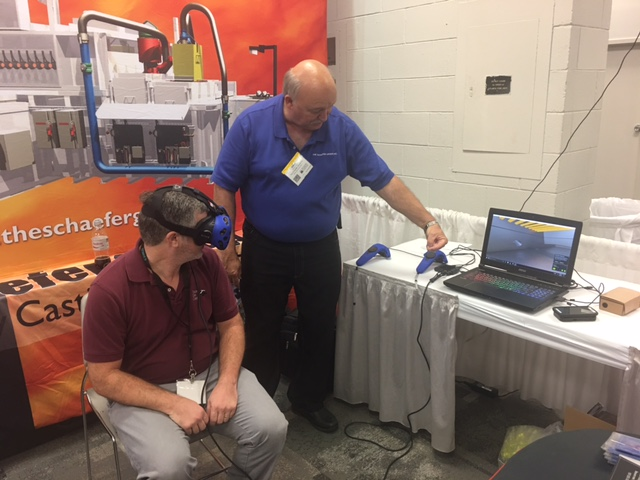 The Schaefer Group's Kent Guthrie demoing VR system at a show.