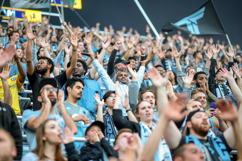 Allianz Field Stadium fans cheering on a soccer game.