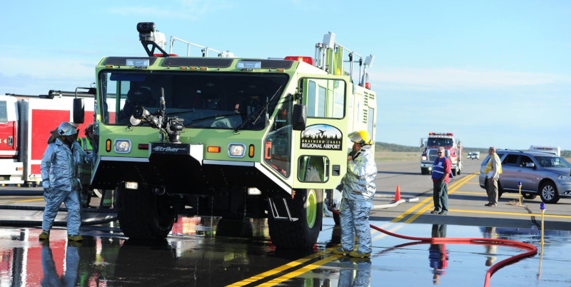 Brainerd Lakes Regional Airport first responders showing a Striker vehicle and persons wearing thermal equipment.