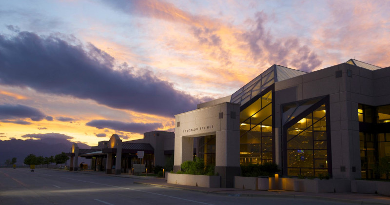 The Colorado Springs Airport, entrance to terminal building near dusk.