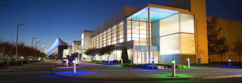 The Hampton Roads Convention Center exterior at dusk.