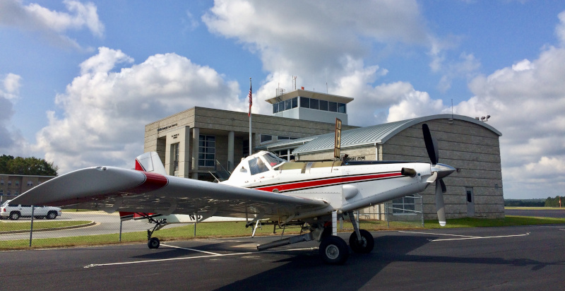 The Heart of Georgia Regional Airport building with a plane parked out front.