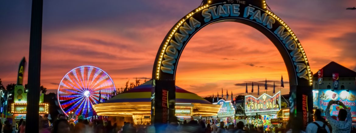 Indiana State Fairgrounds near sunset showing the entrance sign saying welcome to the indiana state fair.