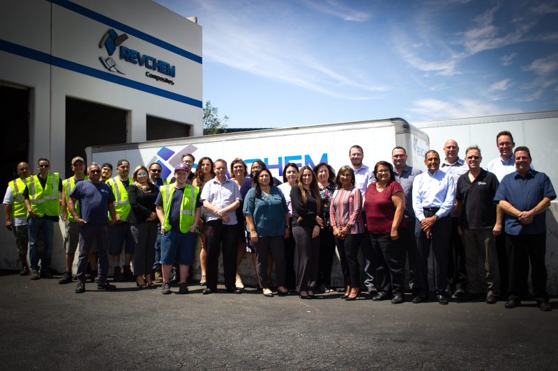 RevChem Composites group photos of employees outside their building in front of a truck.