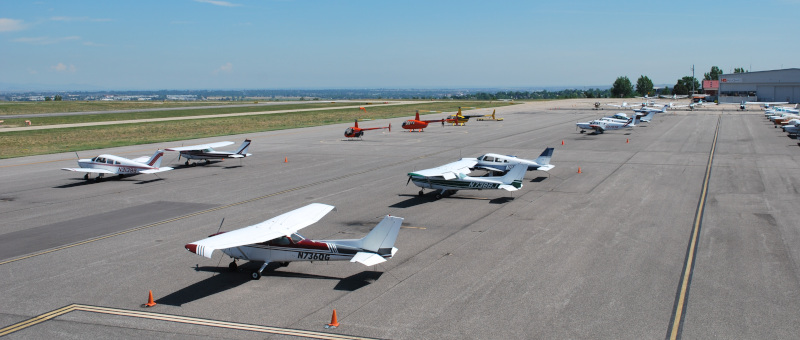 Rocky Mountain Metropolitan Airport runway with small craft parked and in transit.