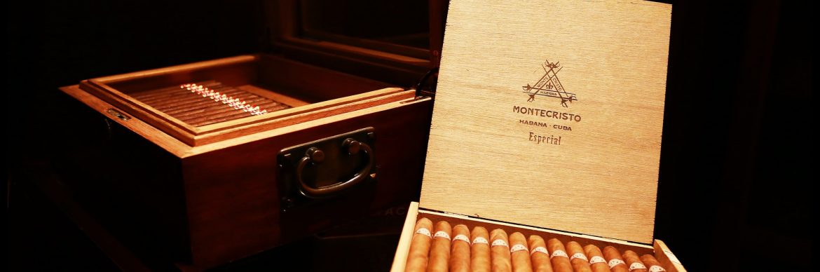 Top Executive Brands featured image showing two wooden boxes of Cuban cigars. Montecristo Especial visible on the right box lid.