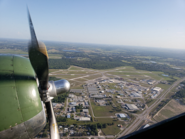 Bartow Executive Airport aerial view from a prop plane and one engine in view.