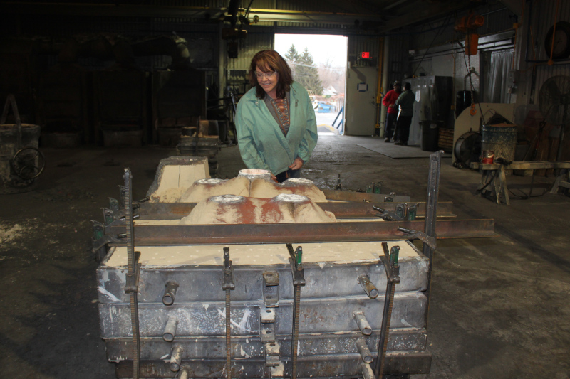 Non-Ferrous Founders' Society Board Member and President of Calumet Brass Foundry (Dolton, Illinois) inspects a mold poured by her production team.