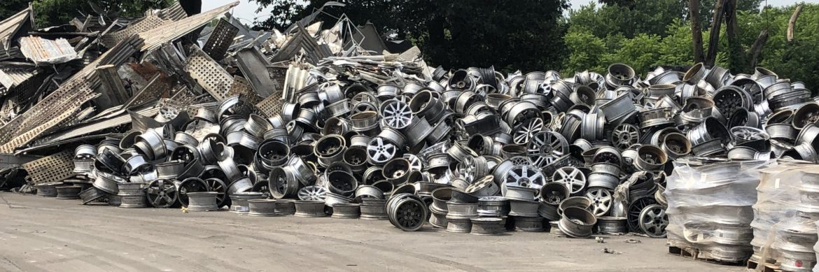 The Non Ferrous Founders' Society aluminum scrap piles on the ground.