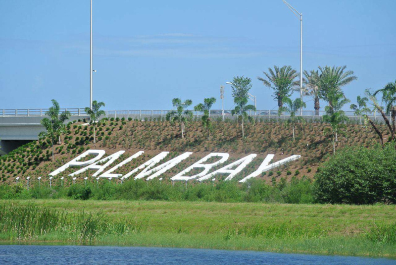 Palm Bay, Florida sign along the highway in the landscaping.