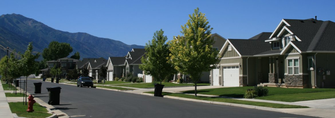 Spanish Fork, Utah houses with a mountain and blue sky in the background.