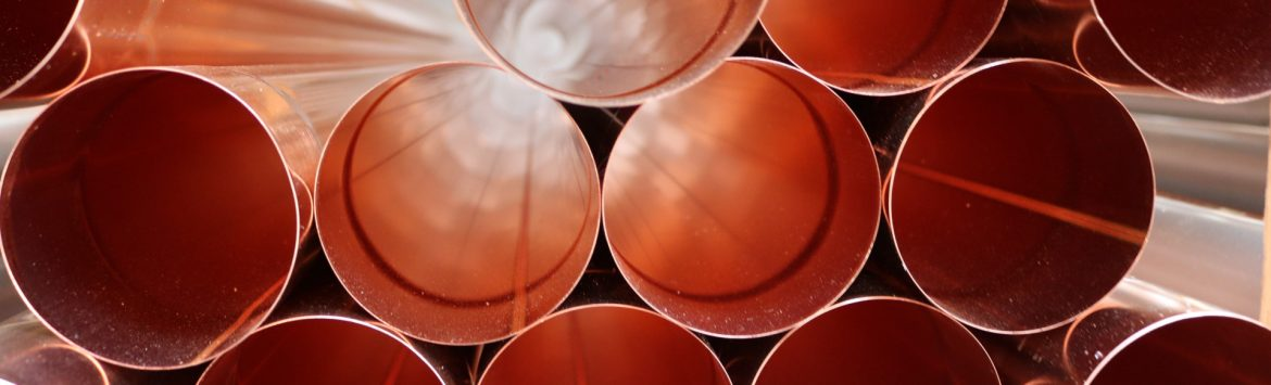 The Copper Development Association, stock photo showing the end view of a stack of copper pipes.