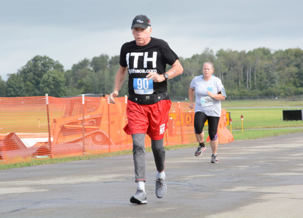 Ithaca Tompkins Regional Airport Director Mike Hall running a marathon at the airport.