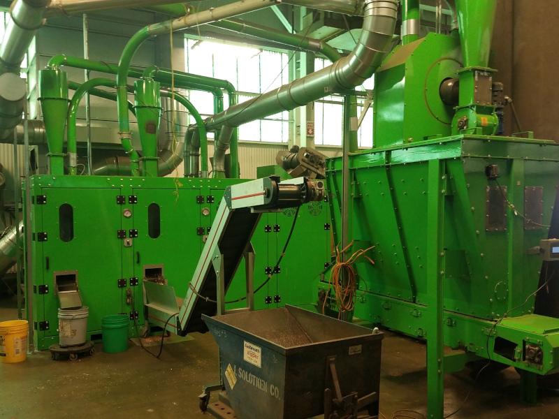 J. Solotken & Company, Inc. green machinery inside building.