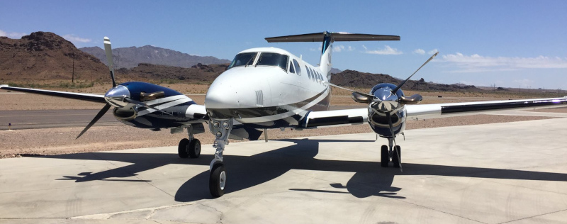 Lake Havasu City Airport, two prop airplane parked on runway.