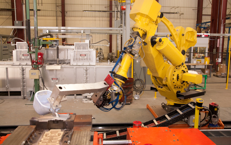 Wolverine Bronze Company robotic arm pouring molten metal.
