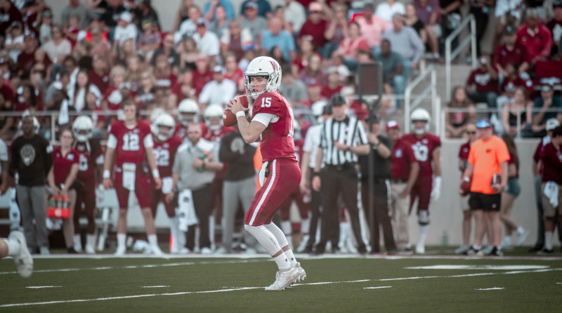 Buffalo Stadium football game with a quarterback getting ready to throw.