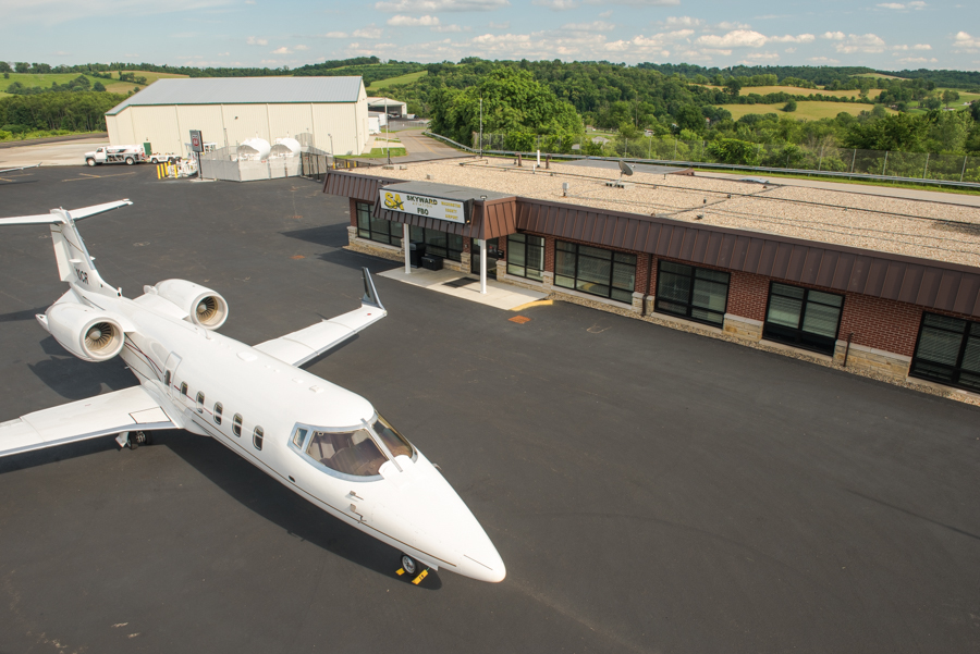 Washington County Airport FBO Exterior with a jet out front.