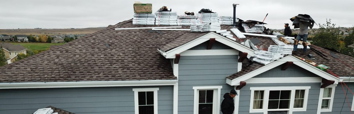 Elite Roofing employees working on a rooftop.