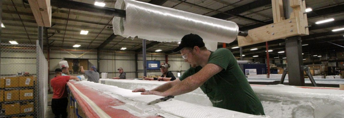 AIT Bridges employees at work on composite materials.