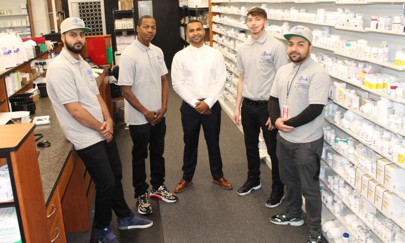 Baybridge Pharmacy Corp emlpoyees posing for a group photo.