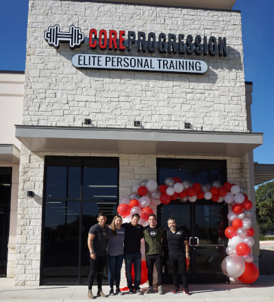 Core Progression Austin Gym with people out front for a group photo.