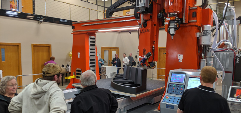 Thermwood Corporation people looking at a large machine.