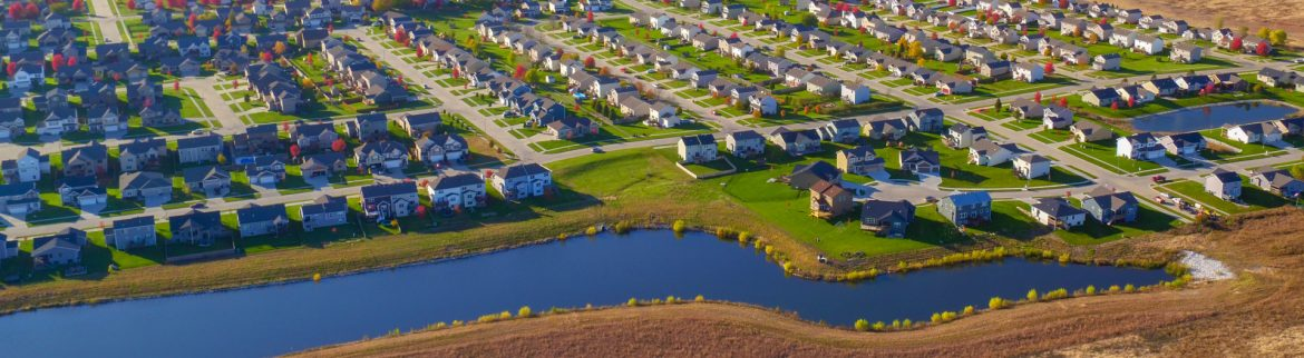 Waukee, Iowa aerial view of Kettlestone with rows of houses and some water..