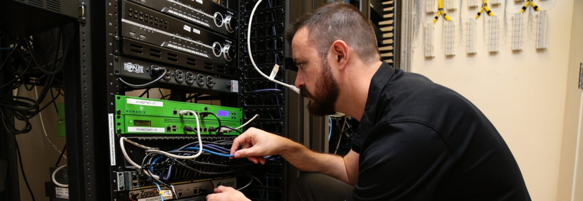 Broadband Hospitality Installation technician working on a server.