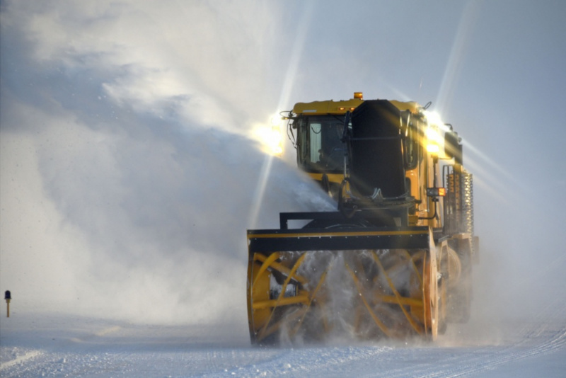 Great Falls International Airport snow removal vehicle in action.