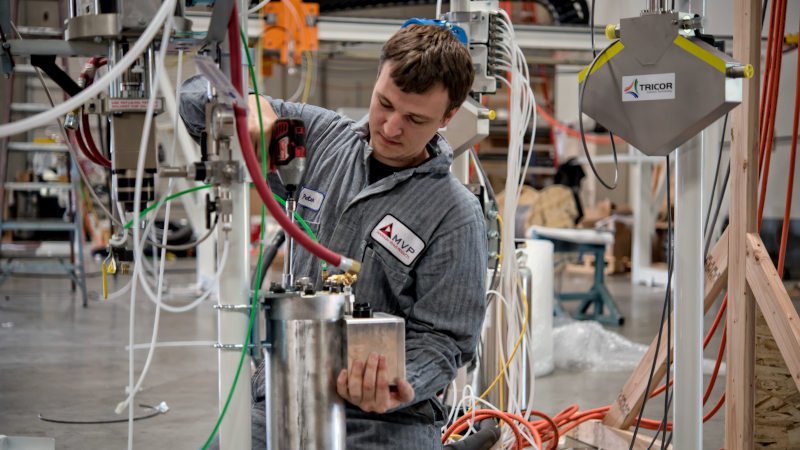 Magnum Venus Products employee working on equipment.
