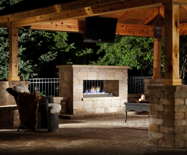 All Seasons Pools & Spas example of work showing an outdoor sitting area with roof, tv and fireplace.