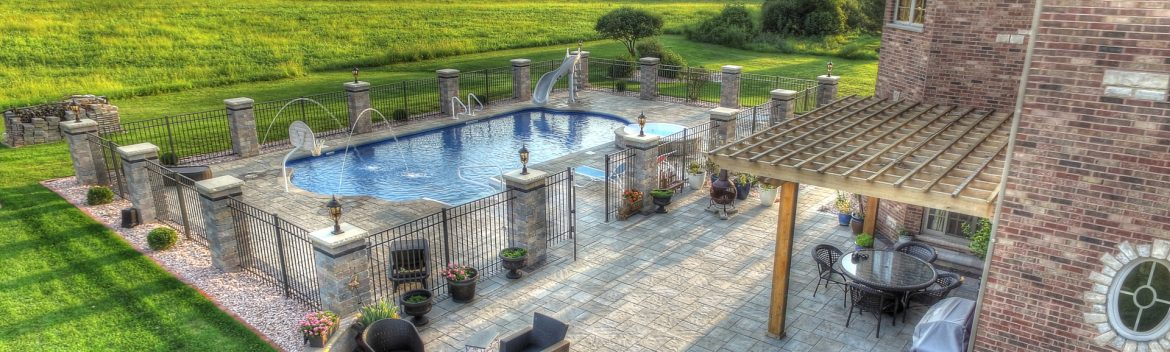 All Seasons Pools & Spas example of work showing a backyard pool at a home.