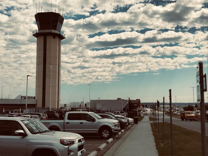 Billings Logan International Airport terminal with clouds.