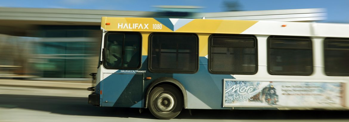 Halifax Transit bus with blurred background in motion.