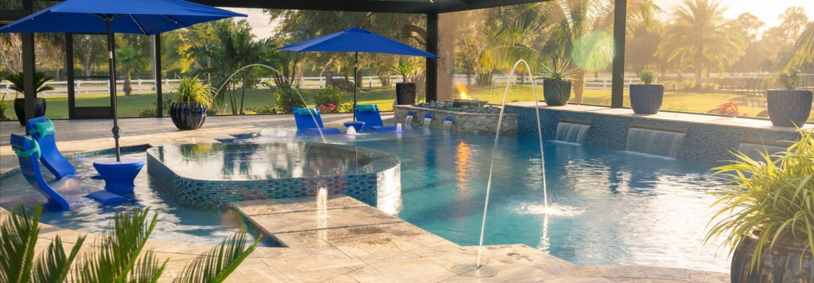 Superior Pools outdoor pool area with in water seating and a fountain.