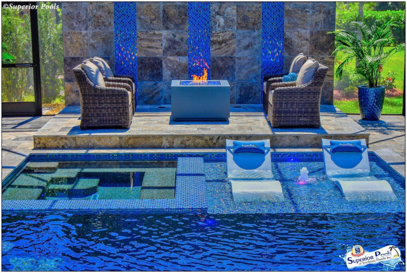 Superior Pools example of work showing an outdoor pool area with seating in and out of the water.