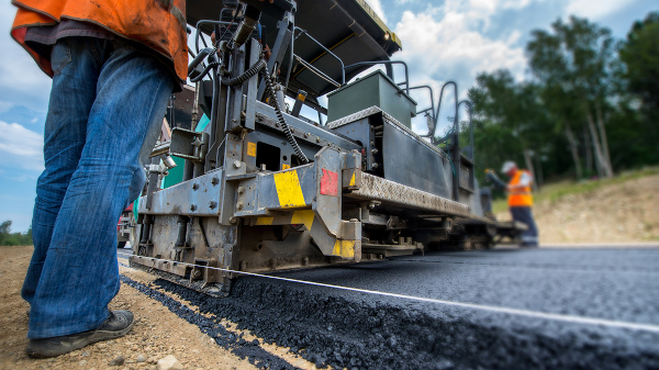 Canadian Public Works Association CPWA stock image of paving a road.