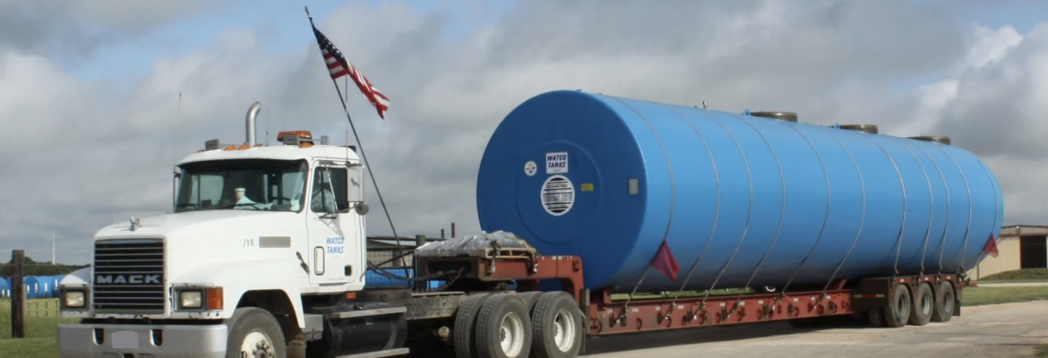 Watco Tanks Inc. Semi Truck with a tank loaded on back.