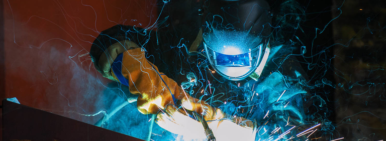 Alloy Products Corp. stock image of a welder welding.