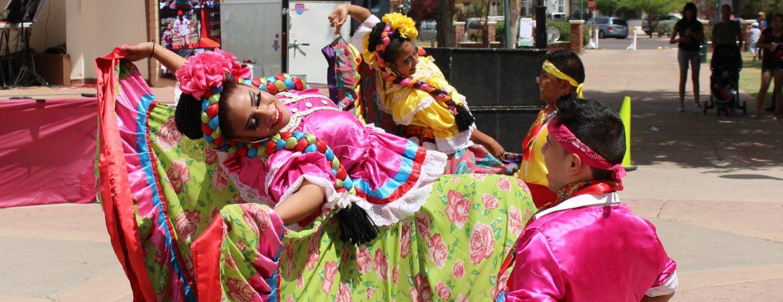 Douglas, Arizona Douglas Days dancers in bright clothing.