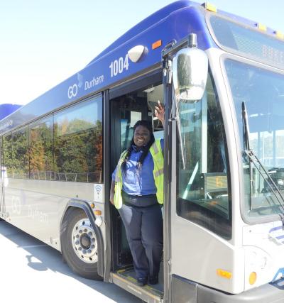 GoDurham bus operator standing in the bus doorway.